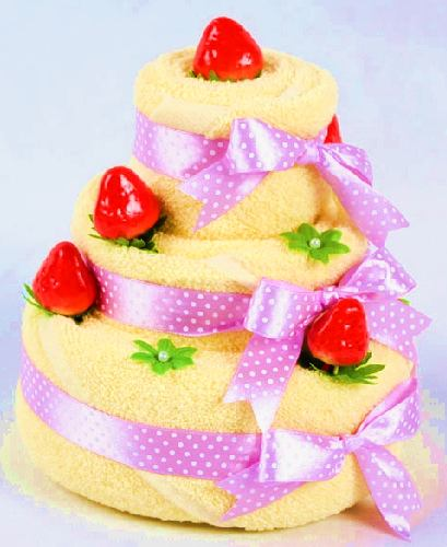 towel origami cake with pink bows