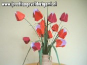 rotating origami tulips in a vase